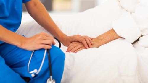 nursing comforting patient
